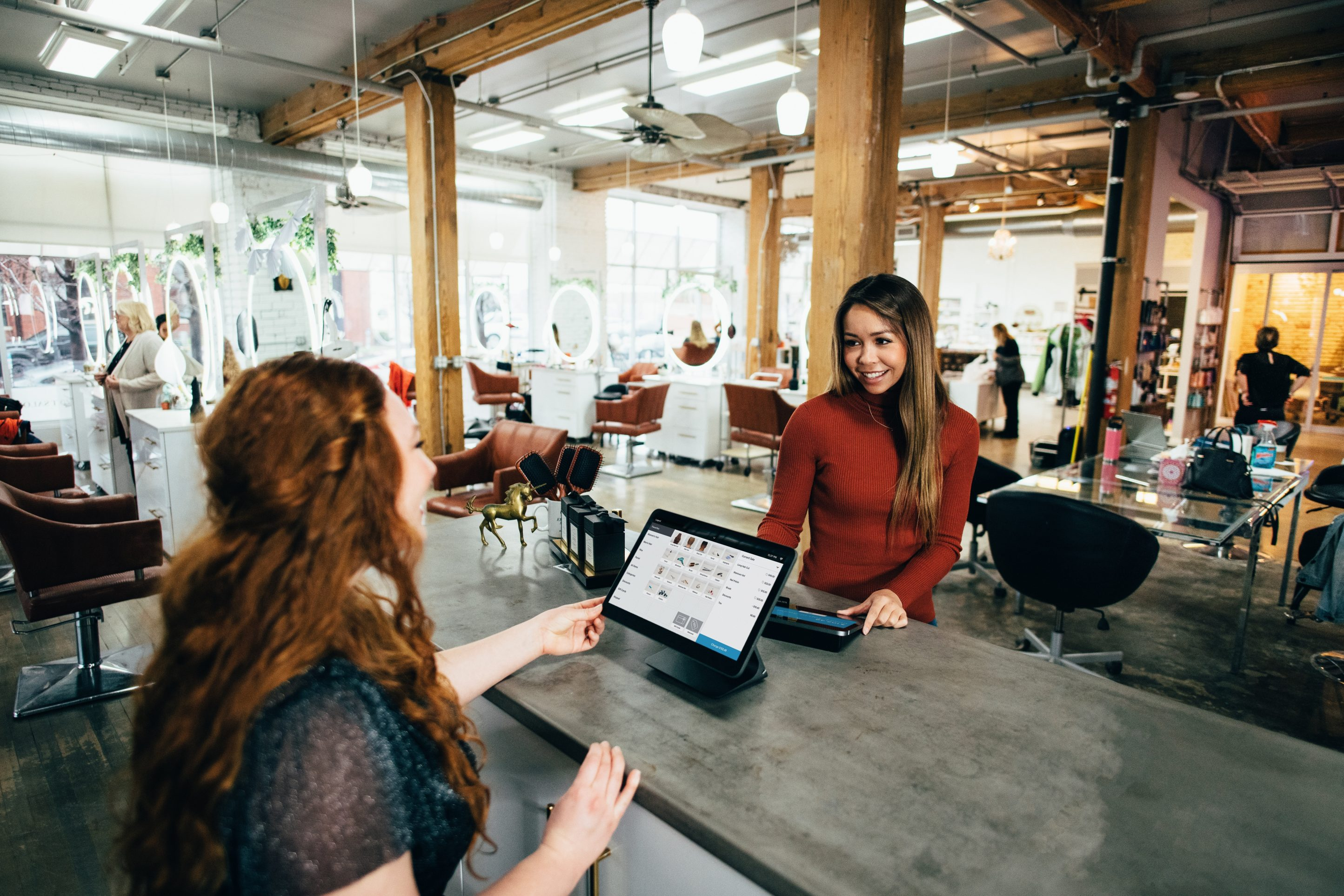 Two women at a Point of Sale transaction